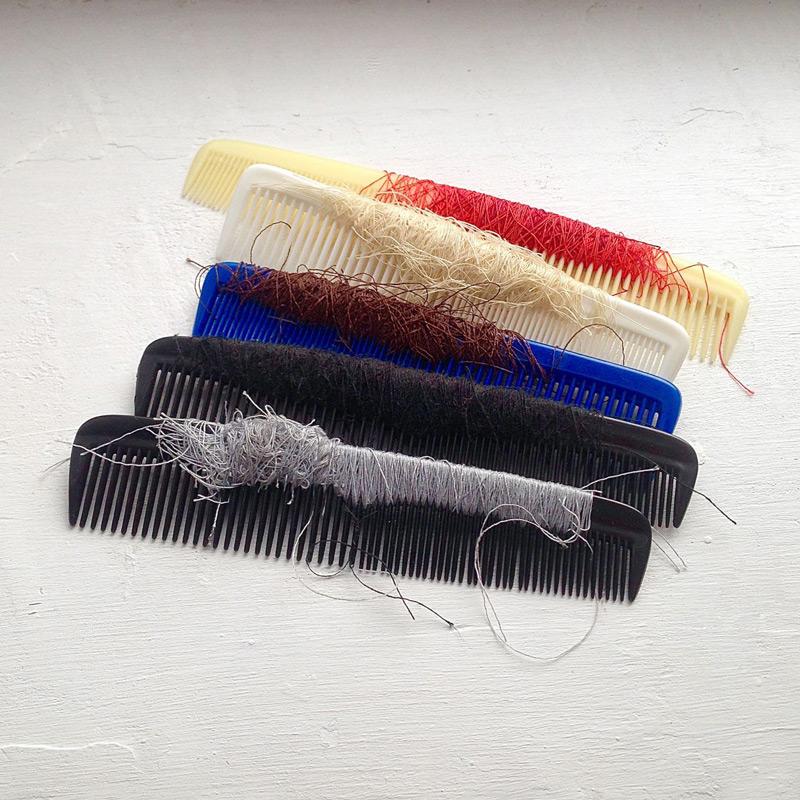 Combing // Kampausta, 1996. Plastic combs, cotton thread